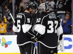 Los Angeles Kings defenseman Jamie McBain (5) celebrates with goalie Jonathan Quick (32) after defeating the Florida Panthers 4-1 during an NHL hockey game in Los Angeles, Saturday, Nov. 7, 2015. The Kings won 4-1. (AP Photo/Alex Gallardo)