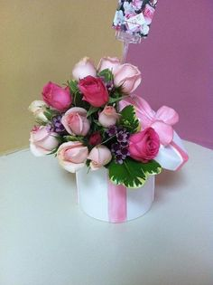 fresh floral arrangement in a ceramic hat box container with hot pink roses, pale pink roses and filler. can make a very cute centerpiece or a gift. Hot Pink Roses, Pale Pink, Floral Flowers, Floral Wreath, Wooden Roses, Hat Party, Flower Designs, Floral Arrangements, Mothers