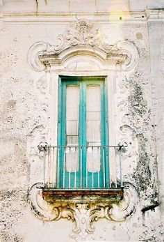 turquoise balcony - a sun-worn side of the house that feels like it's centuries old. a color that stands bold even from a distance.