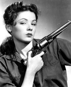 Gene Tierney with Remington cap and ball revolver.