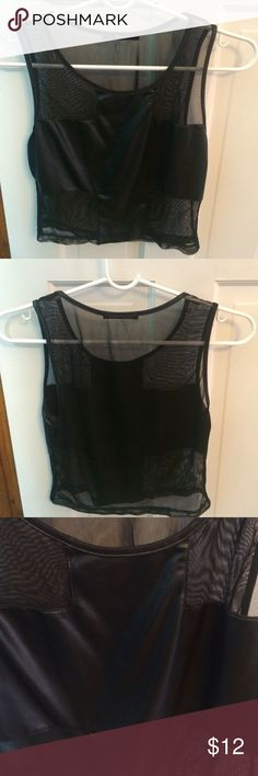 Black leather and sheer crop top Black crop top with half leather and sheer material. It is not too revealing. The leather pattern covers your bust and most of your tummy. The back is complete sheer with no leather coverage. Forever 21 Tops Crop Tops