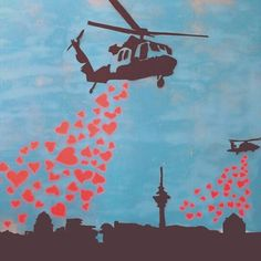 Helicopters Bombing with Love Hearts, NOT BOMBS! Street Art, by Banksy.