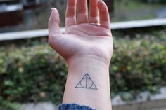 if i were to get a tattoo, it would be this: the deathly hallows