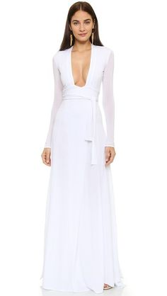An open back and deep V neckline give this ISSA maxi dress a sultry look. A sexy dress for a night out.