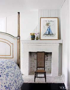 dustjacket attic ~love the print above the fireplace!