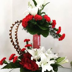 Look at this awesome arrangement of #Red #carnations and white lilies which will be a eye-catching for anyone.You can use it in any events and occasions. Buy or send this beautiful #flower #arrangement and send it to your dear ones in Pune.
