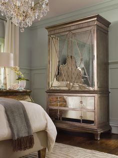 A mirrored armoire is the focal point of an elegant master bedroom. Love the mirrored armoire. Hooker Furniture, Mirrored Furniture, Mirrored Dresser, Luxury Furniture, Metallic Furniture, Style At Home, Home Bedroom, Bedroom Decor, Bedroom Furniture