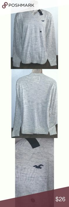 Men's Hollister V Neck Sweater Light comfortable material. Would make a wonderful Valentine's day gift. New with tags. Size xl. Off White in color with splashes of Gray mixed in. 53% cotton 40% viscose, 7% nylon. Hollister  Sweaters V-Neck