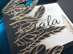 Black & White invitation with feather details