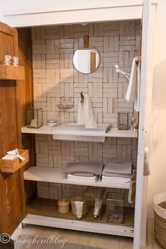 "design trend: mini bathroom in a closet. Love the real tiles on the back and the zinc sink. Image captured at  the ""Woonbeurs Amsterdam"" a residential living event"