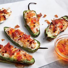 Salty bacon, rich goat cheese, savory-sweet jelly, and roasted jalapeño--it takes teamwork to make the dream work. If you already have the grill going, these dreamy little bites are equally easy to cook outdoors.