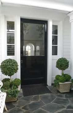Front Door Decor Discover 20 Front Door Ideas that will Boost your Curb Appeal Craftivity Designs A front door flanked with two matching planters is a classic look. Improve your curb appeal with 20 Front Door Ideas for your exterior. Front Door Lighting, Front Door Entrance, Entrance Decor, Front Entrances, Porch Lighting, House Entrance, Front Door Decor, Exterior Lighting, Entrance Ideas