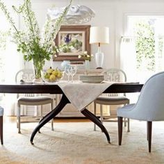 barbara barry dining room with gondola chair Vintage-inspired-furniture-contemporary-chandelier-create