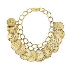 Duchess of Windsor's charm bracelet auctioned at Sotheby's. Elizabeh Taylor purchased thi barcelet at auction. they are Opera tags made out of ivory.