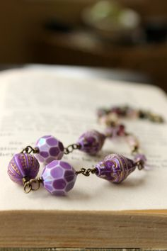 Hey, I found this really awesome Etsy listing at http://www.etsy.com/listing/123073902/purple-beaded-necklace-purple-amethyst