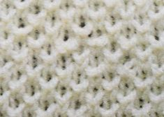 The bee stitch uses the knit one below technique to create an interesting textured design that is great when knitting scarves and blankets. If you are in need of a fast knitting project, use the bee stitch.