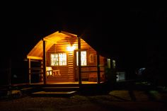 Rustic cabin at night in West Yellowstone