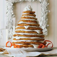 Carrot Cake Pancakes | Use the small holes of a box grater to finely grate the carrots by hand; if you use a food processor, the carrots will be too wet, making the pancakes dense and less tender.