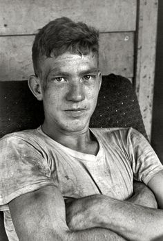 One of the Cornett boys on the front porch after working hard at something. Photo by William Gedney, 1964, part of a series on the Cornett family. Kentucky viahotparade