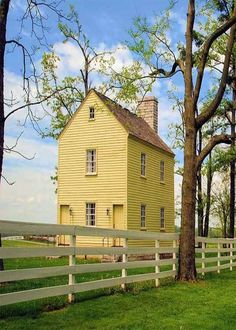 Tall Old Yellow Farm House