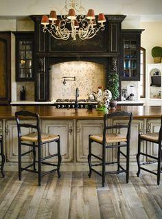 Antiqued cream kitchen with black stove surround
