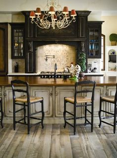 Antiqued cream kitchen with black stove surround