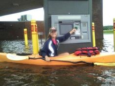Kayak-up ATM...only in Florida...wouldn't that be a fun machine to fill if you worked for the bank?