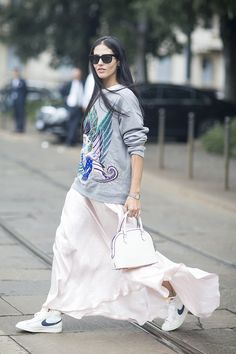 Gilda in a flowing maxi skirt and sneaks. #GildaAmbrosio #MFW
