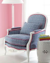 Love the upholstery and the contrast welting on this white painted chair, so fun,just a touch of whimsy.