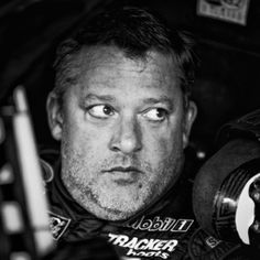 Tony Stewart, driver of the #14 Bass Pro Shops/Mobil 1 Chevrolet, sits in his car in the garage area during practice for the NASCAR Sprint Cup Series Cheez-It 355 at Watkins Glen International on August 7, 2015 in Watkins Glen, New York.