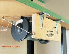 Swing up grinder... a great idea for the tools you don't use every day.