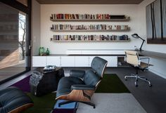 Love the book shelves.  Riverhouse - modern - home office - new york - BWArchitects (formerly Basil Walter Architects)