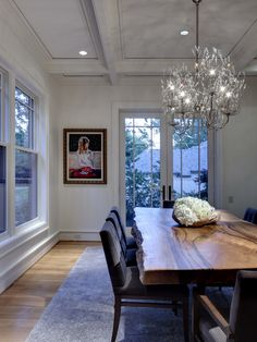 Dining Room Design, Pictures, Remodel, Decor and Ideas - interesting table with crystal chandelier. #dreamhome.  Let me help you find yours.  Johnny Sparrow, Keller Williams