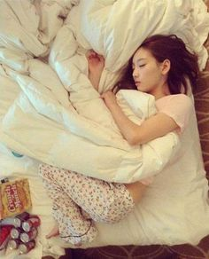 Girls' Generation's Tiffany takes a candid photo of Taeyeon sleeping like a baby | allkpop.com