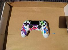 Took apart my DualShock 4 and let me daughter paint it. I think it turned out pretty neat.