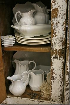 white with shabby chic cabinet ... I collect white dishes, serving pieces, & pitchers, too. LOVE LOVE LOVE