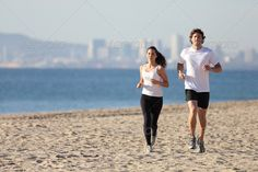 Man and woman running in the beach ...  Barcelona, adult, athletic, background, beach, beautiful, black, buildings, caucasian, city, couple, cute, exercise, female, fit, fitness, friend, front, girl, health, horizon, horizontal, human, jogging, male, man, marathon, muscled, ocean, outdoor, outside, people, person, run, runner, running, sand, sea, speed, sport, sunny, together, town, training, unfocused, water, white, woman, workout, young