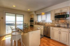kitchen w beautiful bay views at 1 paul clark drive in somers point