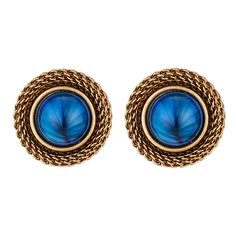 Our Blue Stone Clip Earrings feature elegant antiqued brash mesh surrounding a glass cabochon stone inspired by Ancient Egypt