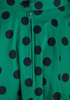 Grab a friend and get on the dance floor, because the rock 'n' roll is jivin' on the jukebox, and your swinging vintage-inspired skirt just can't wait anymore! Black polka dots jazz up this emerald-green circle skirt, which twists and swirls as you and your dance partner move in sync to the music. Black kitten heels and a tie-waist blouse complete your bold ensemble - a rare, retro look that's bound to be the movin' and groovin' hit of the evening!