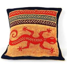 Handmade in Zimbabwe, this 17-inch square cushion cover has a batiked design on cotton canvas and a plain cotton back. With a flap closure and finished with contrasting piping, the cover will fit a standard 16 inch cushion pillow (not included).