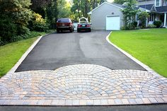 Asphalt, Concrete or Pavers? Which Driveway is Right for You? I like this if it was just toned down Gravel Driveway Cost, Driveway Paving, Driveway Design, Driveway Landscaping, Driveway Ideas, Driveway Entrance, Luxury Landscaping, Walkway, Tarmac Driveways