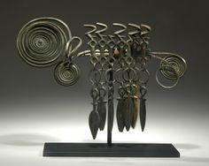 CENTRAL EUROPEAN BRONZE AGE FIBULA OF THE PASSEMENTERIE TYPE. Ca. 1200 BC. Fibulae are fancy clothes pins.
