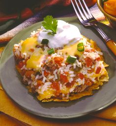 Tex Mex Bake #recipe using @SuccessRice, ripe tomatoes, spicy green chilies, hearty ground beef and seasoned pinto beans.
