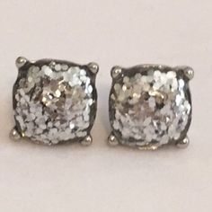 Large Silver Sparkle Stud Earrings Beautiful Large Sparkle Gumdrop Stud Earrings in a silver color with silver glitter set in the resin stones. Gives an iridescent look. Approximate size of a dime or penny. New. No Trades, No PP. Boutique Jewelry Earrings