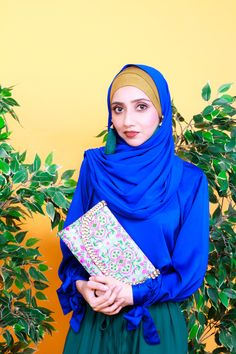 Modest Fashion with Hijab and accessories or to speak earrings. Azure Blue Top and Opal Green Bottom. With Clutch on turquoise and magenta. Zaryluq is modesty with Confidence. Blue Fashion, Modest Fashion, Modest Wear, Blue Tops, Magenta, Opal, Confidence, Turquoise, Stylish