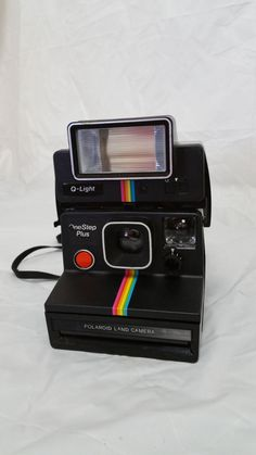 Polaroid One Step Plus Instant Camera w/Q Light. includes manuals for camera and…