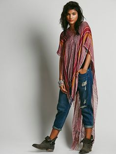 Free People Highs and Lows Poncho at Free People Clothing Boutique ~ This would be great for my trip to Dubai!