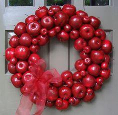 RED APPLE WREATH $114.00 or DIY crafts  Shiny red apples create a handsome wreath you can use in spring, summer and through the holidays. This large wreath is perfect for our patriotic holidays and for the Christmas season too. It's finished with a matching red bow