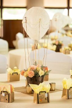 Hot air balloon centerpiece with lace, pearls, and dried flowers in the Waikapu Ballroom at The King Kamehameha Golf Club http://www.MauiBanquets.com